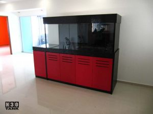 6ft-9 - Custom-made by N30 Singapore. Aquarium is encased in a Black Top and Bottom Red cabinet. Best of black/red combination. An extended cabinet serves as desktop space for keys, phones etc.