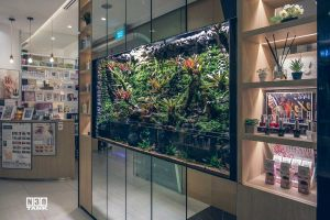 Aquarium with side shelving. Entire aquarium and cabinets are custom-made by N30 Singapore.