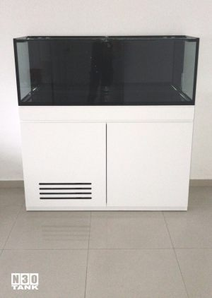 Unique-018: Low-profile cabinet tank set custom-made by N30. This 2-door aquarium cabinet sits elegantly in the room, and the dark tank is contrasted against a light-colour wall.